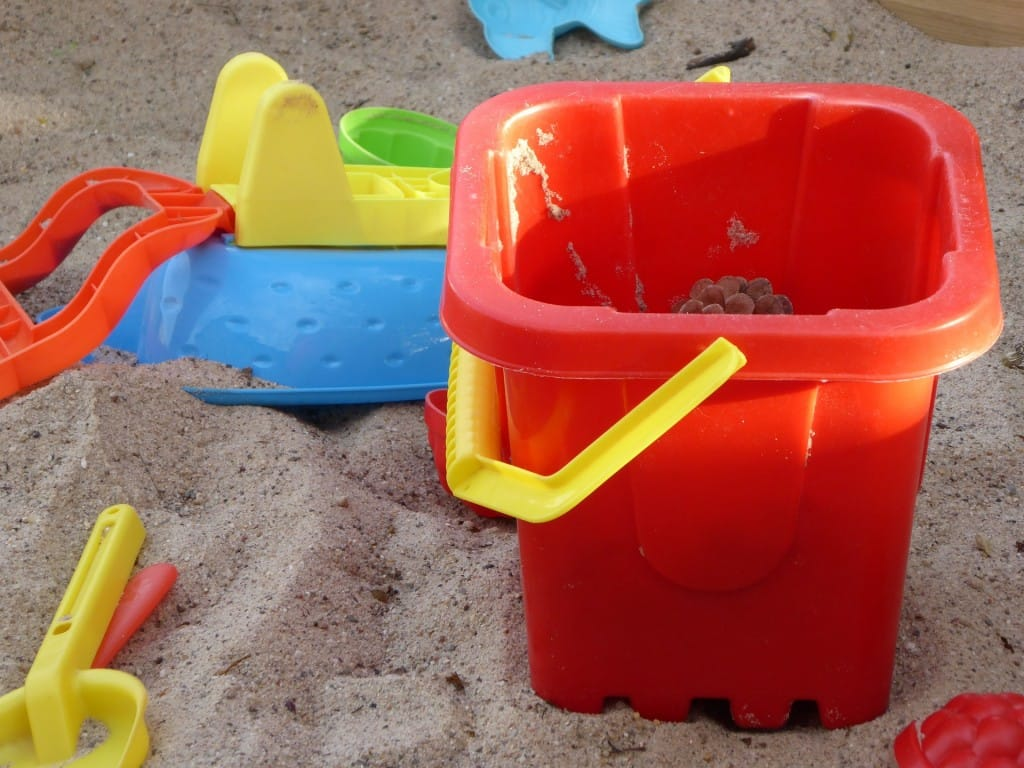 Sand pails are a must at the beach. Check out this post for other Beach Day essentials