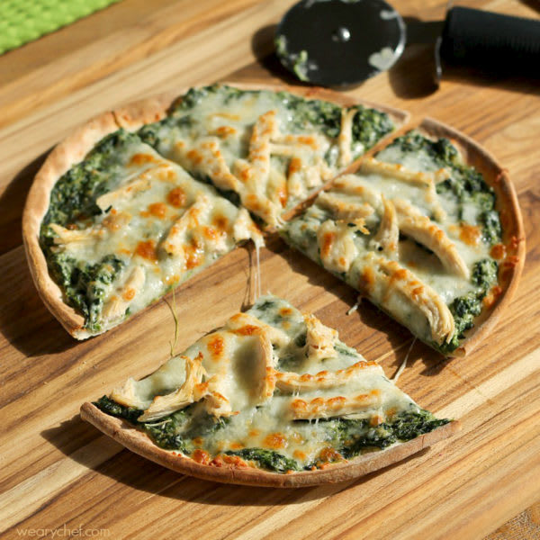With the help of Ragu Alfredo Sauce, this Turkey and Spinach Alfredo Pizza comes together to easily, and is so delicious, you may forget you are even eating leftovers!