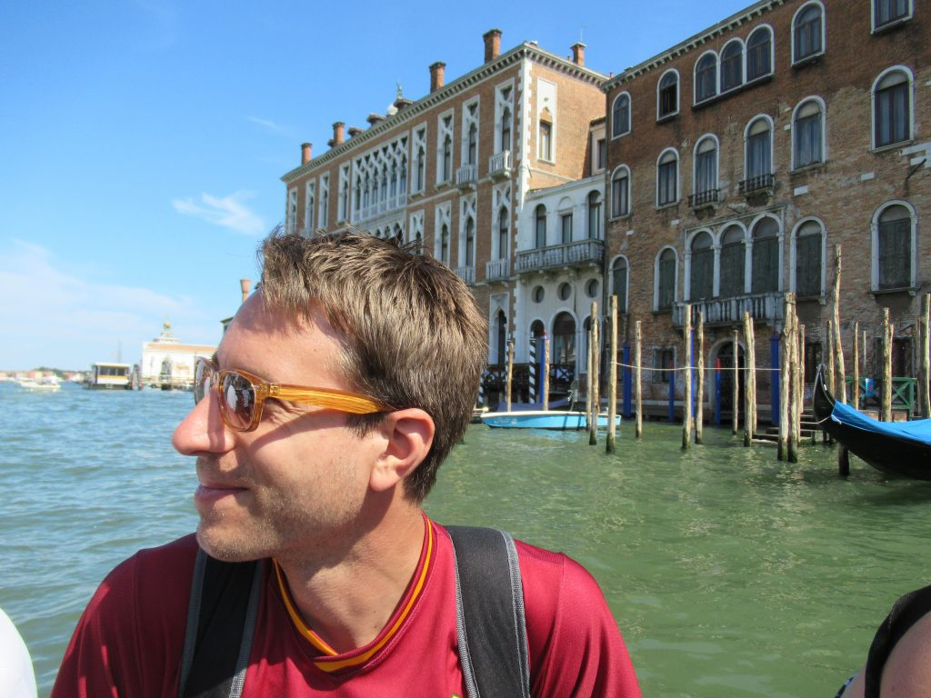 Budget Travel Hack: A gondola ride will set you back 80 Euro ( 100 if it's past 7 p.m.). But, you can do as commuters do and ride the traghetto just across a canal for 2 Euro. Take a photo (like I snapped here of Mr. L) and your friends back home will be none the wiser.