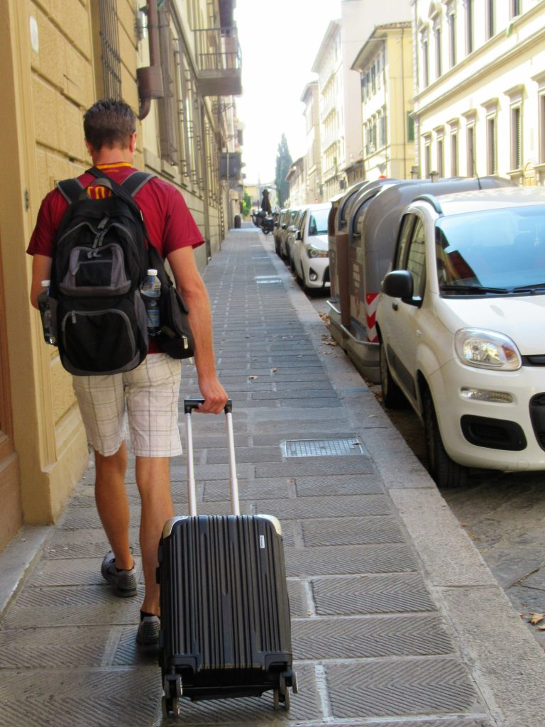 We like to travel light so I encourage only taking a backpack and carry-on suitcase, even when traveling overseas.